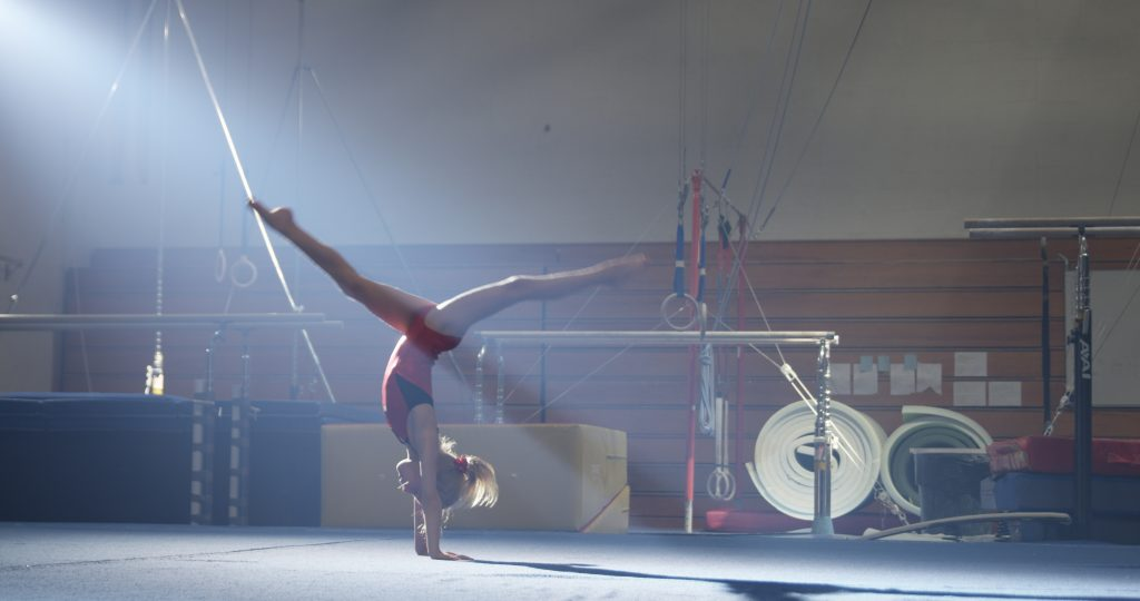 Student doing a handstand