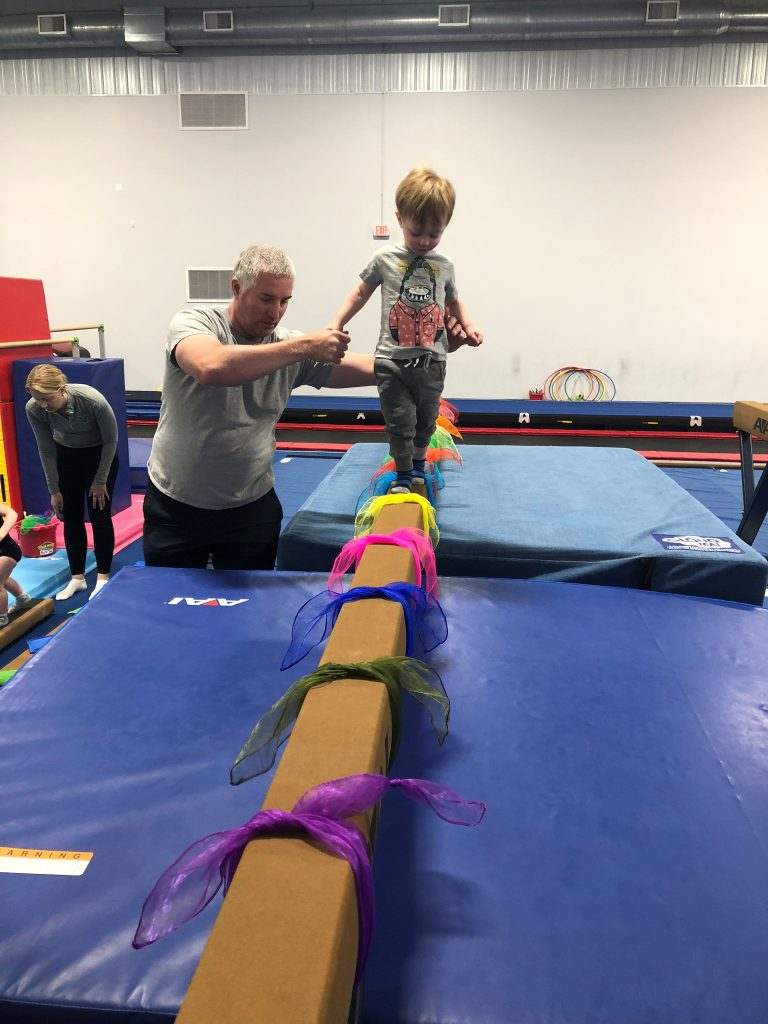 A child on a balance beam