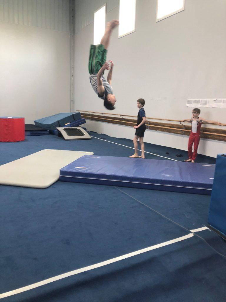 Boy doing a flip