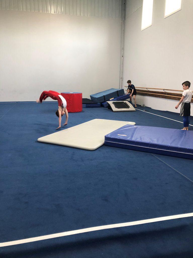 Boy doing a back flip
