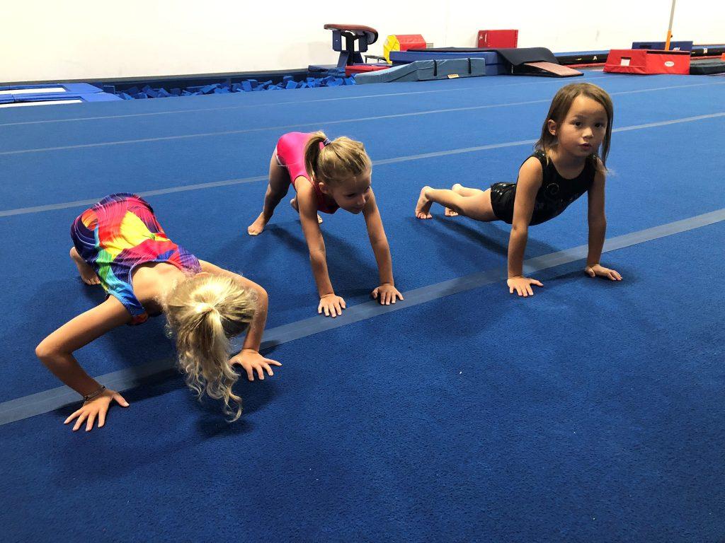 Children doing gymnastics poses