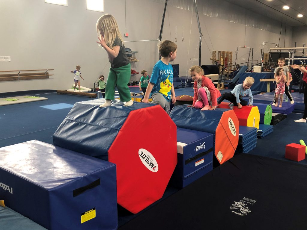 Kids enjoying the gymnastics space at a birthday party
