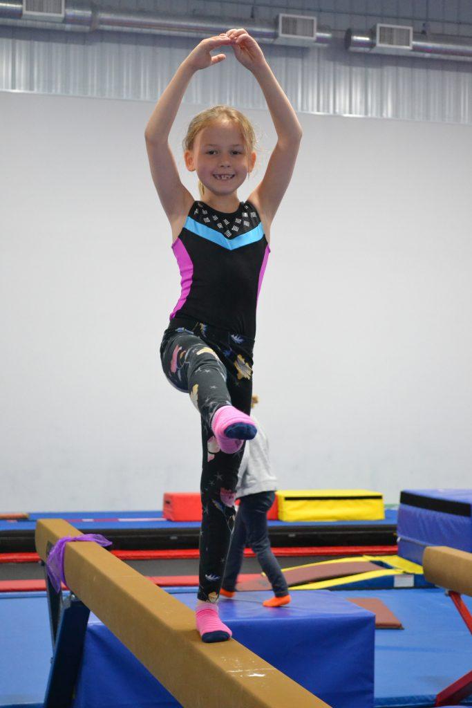 A girl on a balance beam