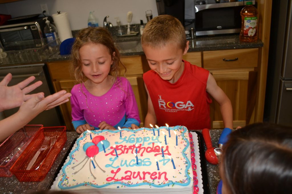 Birthday kids with their cake