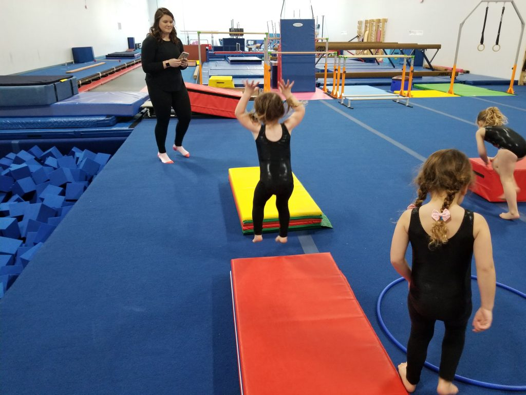 Children practicing straight jumps